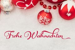 German slogan. `Frohe Weihnachten` Merry Christmas on greeting card as background Royalty Free Stock Photos