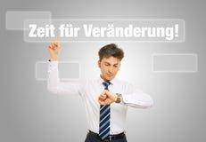 German slogan. Zeit für Veraenderung (time for change) with business man checking his watch Stock Photography