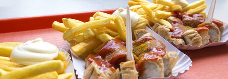 German snack currywurst with french fries Royalty Free Stock Photos