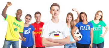 German soccer with blond hair with fans from other countries Stock Photos