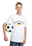 German soccer fan with ball and blond hair Stock Photos