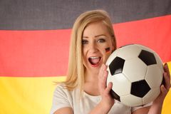 German soccer fan cheers football team. Royalty Free Stock Photography