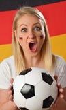 German soccer fan cheers football team. Stock Photography