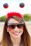 German soccer fan. Girl with german fan outfit and sun glasses Royalty Free Stock Image