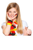 German soccer fan showing on copyspace. German fan pointing on a white placard with blank space for text Stock Images