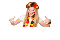 German soccer fan showing on copyspace. German fan pointing on a white placard with blank space for text Stock Photography