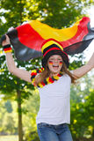 German soccer fan waving her flag stock photography