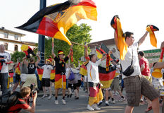 German soccer fans celebrating a victory. German soccer fans dancing and waving their flags on the street during the world championship 2010 royalty free stock photos