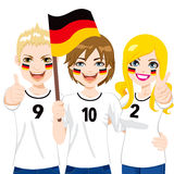 German Soccer Fans. Young German soccer fans cheering their Germany national football team Royalty Free Stock Images