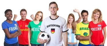 German soccer supporter with ball and fans from other countries royalty free stock photos
