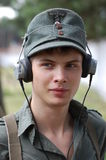 German soldier in earphones. Royalty Free Stock Photo