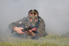 German soldier in gas mask . WW2 reenacting Royalty Free Stock Image