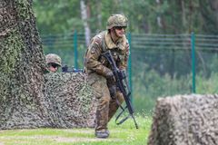 German soldier with hk g 36 rifle on assault course. BURG / GERMANY - JUNE 25, 2016: german soldier with hk g 36 rifle on assault course , at open day in barrack Royalty Free Stock Image