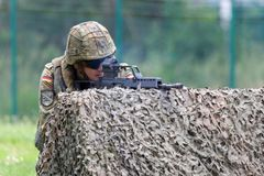 German soldier with hk g 36 rifle on assault course. BURG / GERMANY - JUNE 25, 2016: german soldier with hk g 36 rifle on assault course , at open day in barrack Royalty Free Stock Photo