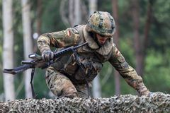 German soldier with hk g 36 rifle on assault course. BURG / GERMANY - JUNE 25, 2016: german soldier with hk g 36 rifle on assault course , at open day in barrack Stock Photo