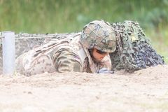 German soldier with hk g 36 rifle on assault course. BURG / GERMANY - JUNE 25, 2016: german soldier with hk g 36 rifle on assault course , at open day in barrack Stock Photography