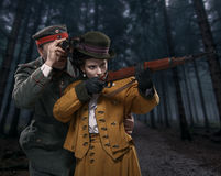A German soldier with the lady on the hunt in the woods Royalty Free Stock Images