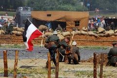 German soldier-reenactor fights holding an old German flag Stock Image