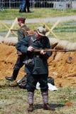 German soldier-reenactor loads a gun. Royalty Free Stock Images