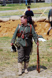 German soldier-reenactor stand holding a gun. Royalty Free Stock Photos