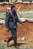 German soldier-reenactor walks on the battle field Royalty Free Stock Photo