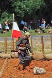 German soldier-reenactor walks with a gun. Stock Photos