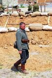 A German soldier-reenactor walks on the sandy ground. Royalty Free Stock Photo