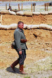 A German soldier-reenactors walks along the fight line Stock Image