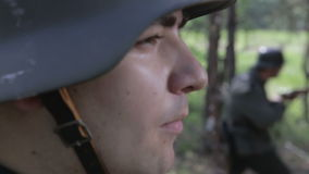 German soldiers are combing the woods. World war II. The reconstruction of the battle stock video