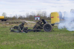 German soldiers firing from anti-tank guns. Reconstruction of the episode of the great Patriotic war Stock Photos