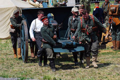 German soldiers-reenactors carry a cannon Royalty Free Stock Images
