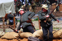 German soldiers-reenactors falling on the ground being wunded Stock Photo