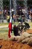 German soldiers-reenactors fight on the battle field. Royalty Free Stock Photo