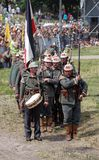 German soldiers-reenactors march with guns. Stock Photo