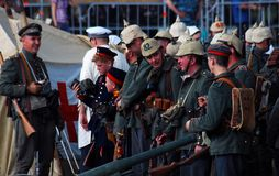 German soldiers-reenactors pose for a photo. Royalty Free Stock Photos
