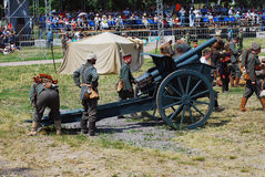 German soldiers-reenactors prepare a cannon for the fight Royalty Free Stock Photography