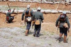 German soldiers-reenactors run on the battle field Royalty Free Stock Photography