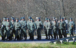 German soldiers-reenactors walk with guns Royalty Free Stock Images