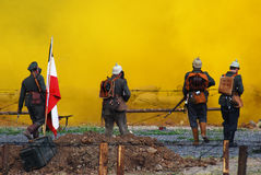 German soldiers-reenactors walk towards the yellow fume Stock Photo