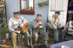 German soldiers relaxing during World War II reenactment Royalty Free Stock Image
