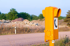 German sos call box on an empty road. A german sos call box on an empty road stock images