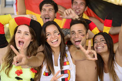 German sport soccer fans celebrating victory. Group of enthusiastic German sport soccer fans celebrating victory Royalty Free Stock Photography