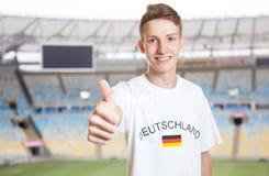 German sports fan at stadium showing thumb up Stock Photo