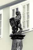 German statue infront of windows. The foto is shot in Coburg, Bavaria, Germany. It shows a middle age statue infront of some windows Royalty Free Stock Image