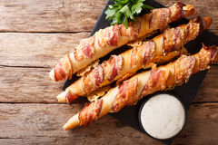 German sticks with bacon and cheese close-up on the table and ga Stock Image