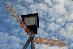 German street signs. A view look up at street signs on a lamp post in Landshut, Bavaria, Germany Royalty Free Stock Images