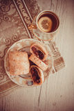 German strudel with cherry. Sweet cherry strudel of puff pastry; two slices on plate stock images