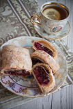 German strudel with cherry. Sweet cherry strudel of puff pastry; two slices on plate stock photos