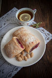 German strudel with cherry. Sweet cherry strudel of puff pastry; two slices on plate royalty free stock photography