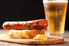 German style sausage. Bratwurst  sausage with beer and mustard Royalty Free Stock Photo